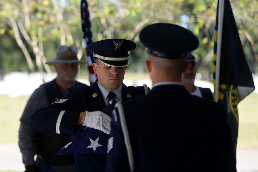 Keesler Air Force Base Honor Guard members practice flag folding procedures before a funeral ceremony Oct. 26, 2017, at the Biloxi National Cemetery in Biloxi, Mississippi. The honor guard's primary function is to support funerals, but when not performing funeral honors the honor guard team is available to post colors or perform flag folding ceremonies for most special events and retirements on base. (U.S. Air Force photo by Airman 1st Class Suzanna Plotnikov)