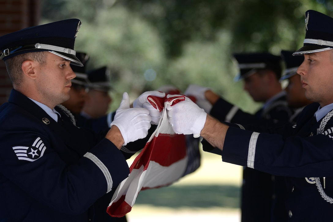 Keesler Air Force Base Honor Guard members practice flag folding procedures before a funeral ceremony Oct. 26, 2017, at the Biloxi National Cemetery in Biloxi, Mississippi. The mission of the Keesler Air Force Base Honor Guard is to represent the Air Force by providing military honors at the request of families for fallen military members. (U.S. Air Force photo by Airman 1st Class Suzanna Plotnikov)