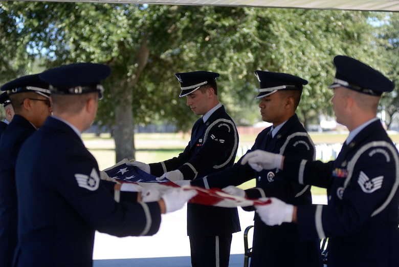 Keesler Air Force Base Honor Guard members practice flag folding procedures before a funeral ceremony Oct. 26, 2017, at the Biloxi National Cemetery in Biloxi, Mississippi. Every month the Keesler Honor Guard participates in a monthly funeral ceremony at the Biloxi National Cemetery to honor the unaccompanied remains of military members. (U.S. Air Force photo by Airman 1st Class Suzanna Plotnikov)