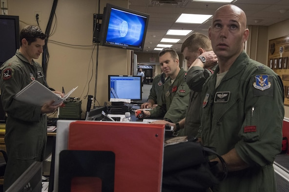 Pilots from the 75th Fighter Squadron receive a pre-departure briefing, Oct. 31, 2017, at Moody Air Force Base, Ga. Pilots, traveled to Eglin AFB, Fla., to participate in exercise COMBAT HAMMER. The exercise evaluates the effectiveness, maintainability, suitability and accuracy of precision guided munitions and high technology air to ground munitions from tactical deliveries against realistic targets with realistic enemy defenses. Moody's team will be assessed and trained on how accurately and quickly a munition is built, loaded onto the aircraft and dropped from the aircraft onto a target. (U.S. Air Force photo by Senior Airman Janiqua P. Robinson)