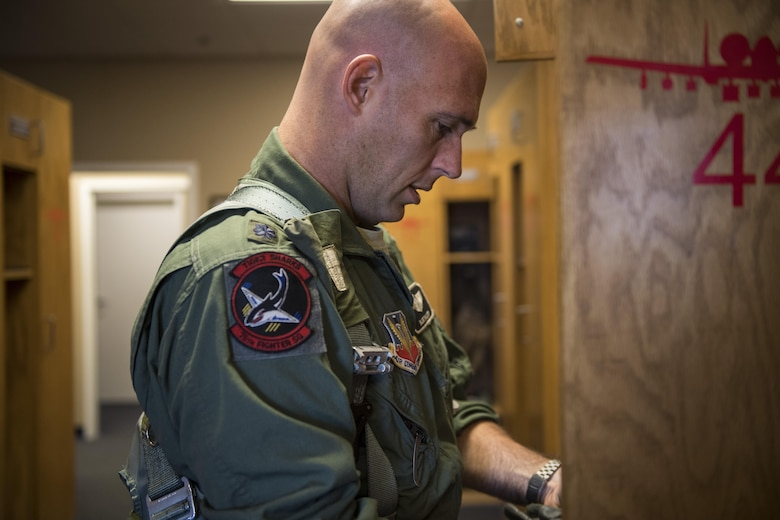 Lt. Col. Edward Balzer, 75th Fighter Squadron assistant director of operations, gathers his gear before departing for a flight, Oct. 31, 2017, at Moody Air Force Base, Ga. Pilots, traveled to Eglin AFB, Fla., to participate in exercise COMBAT HAMMER. The exercise evaluates the effectiveness, maintainability, suitability and accuracy of precision guided munitions and high technology air to ground munitions from tactical deliveries against realistic targets with realistic enemy defenses. Moody's team will be assessed and trained on how accurately and quickly a munition is built, loaded onto the aircraft and dropped from the aircraft onto a target. (U.S. Air Force photo by Senior Airman Janiqua P. Robinson)