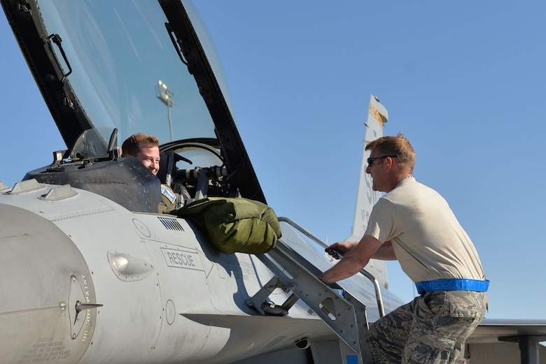 "U.S. Air Force Senior Master Sgt. Daniel Henderson, 20th Aircraft Maintenance Squadron, 55th Aircraft Maintenance Unit, ""Shooters"" assistant superintendent, descends the ladder of an F-16CM Fighting Falcon, prior to 1st Lt. Brian Davis, 55th Fighter Squadron F-16 pilot, taking off at Nellis Air Force Base, Nevada, Oct. 10, 2017."