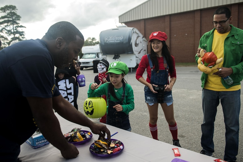 A Team Shaw family trick-or-treats at the ninth annual Boo Bash at Shaw Air Force Base, South Carolina, Oct. 28, 2017.