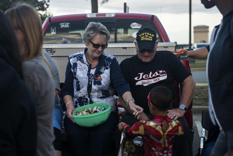 Team Shaw members hand out candy to children at Shaw Air Force Base, South Carolina, Oct. 28, 2017.