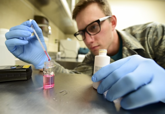 Senior Airman Jordan Loveless, the Bioenvironmental Engineering special surveillance program manager assigned to the 28th Medical Operations Squadron, tests the pH of a water sample inside a lab at Ellsworth Air Force Base, S.D., Oct. 27, 2017. Airmen from BE are responsible for monitoring water quality on base monthly as well as during contingencies. (U.S. Air Force photo by Airman 1st Class Randahl J. Jenson)