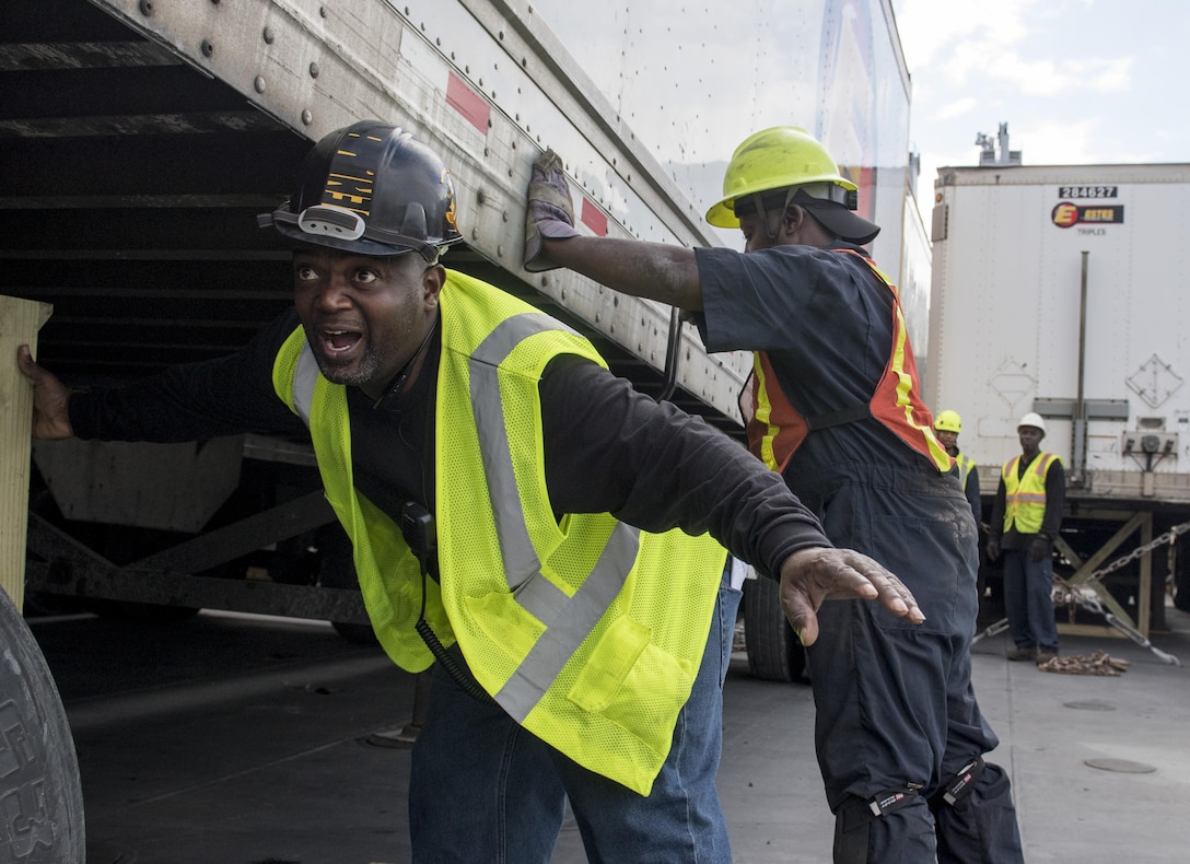 A longshoreman secures a 54-foot trailer to the USNS Brittin (T-AKR-305) Oct. 28, 2017, at Joint Base Charleston's Naval Weapons Station, S.C.
