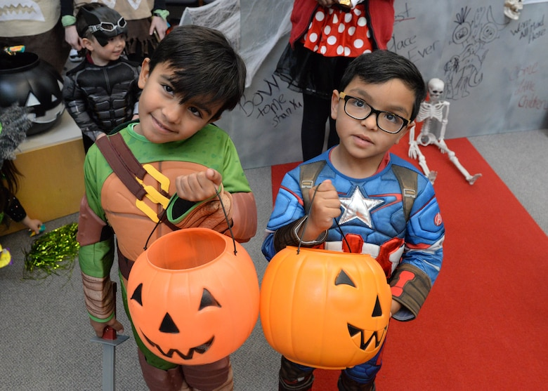Rodrigo, 5, and Gustavo, 4, participate in the annual 673d Medical Group trick-or-treat event at the hospital on Joint Base Elmendorf-Richardson, Alaska, Oct. 27, 2017. Costumed JBER hospital workers with themes picked by their individual clinics will hand out candy to people of all ages during the annual event scheduled for Oct. 26, 2018.
