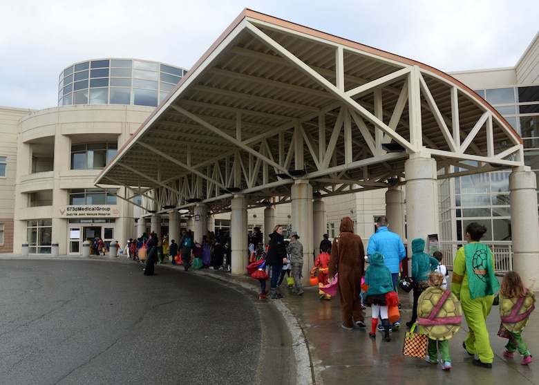 Families line up for the trick-or-treat event at the hospital on Joint Base Elmendorf-Richardson, Alaska, Oct. 27, 2017. Costumed JBER hospital workers with themes picked by their individual clinics will hand out candy to people of all ages during the annual event scheduled for Oct. 26, 2018.