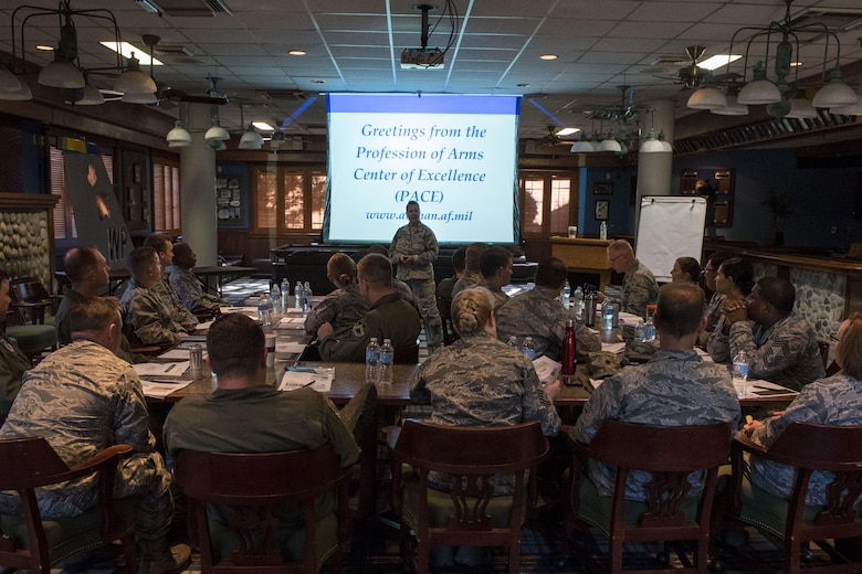 U.S. Air Force Col. Polly Kenny, Profession of Arms Center of Excellence senior consultant, speaks with participants during the Leadership Behavior DNA workshop at Kunsan Air Base, Republic of Korea, Sep. 1, 2017. Throughout the workshop, hosted by PACE, leadership from different organizations around Kunsan learned how to better themselves as leaders by gaining a better understanding of varying factors and traits involved with in interpersonal communications and leadership decision-making. (U.S. Air Force photo by Senior Airman Michael Hunsaker)