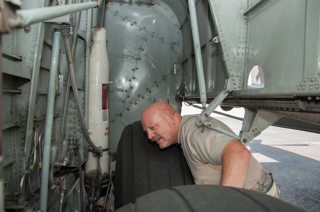 Master Sgt. Norbert Feist, 386th Expeditionary Aircraft Maintenance Squadron crew chef inspects the right wheel well on aircraft 1004 Wednesday, August 30th, at an undisclosed location in Southwest Asia. Feist has been the dedicated crew chief for aircraft 1004 for 21 years. (U.S. Air Force photo by Master Sgt. Eric M. Sharman)