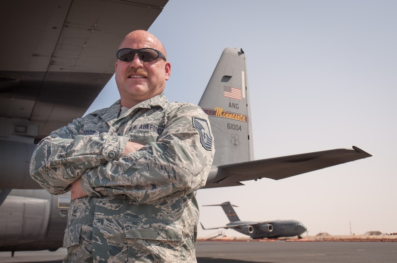 Master Sgt. Norbert Feist, 386th Expeditionary Aircraft Maintenance Squadron crew chef poses for a photograph alongside aircraft 1004 Wednesday, August 30th, at an undisclosed location in Southwest Asia. Feist has been the dedicated crew chief for aircraft 1004 for 21 years. (U.S. Air Force photo by Master Sgt. Eric M. Sharman)