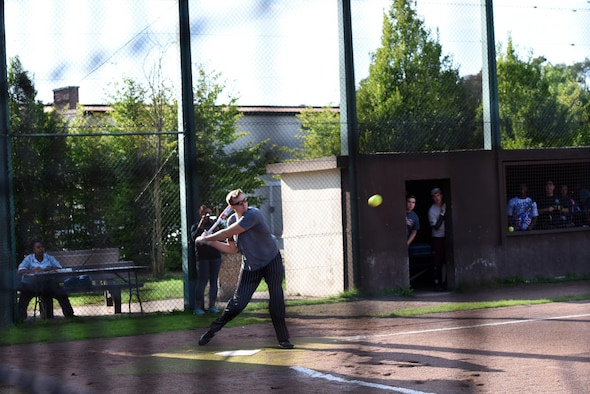 U.S. Air Force Staff Sgt. Theron Green, 86th Maintenance Squadron job title, swings at a softball during an intramural soft ball game on Ramstein Air Base, Germany, Aug. 22, 2017. The intramural softball games boost morale amongst Airmen at Ramstein. (U.S. Air Force photo/Airman 1st Class Milton Jr. Hamilton)