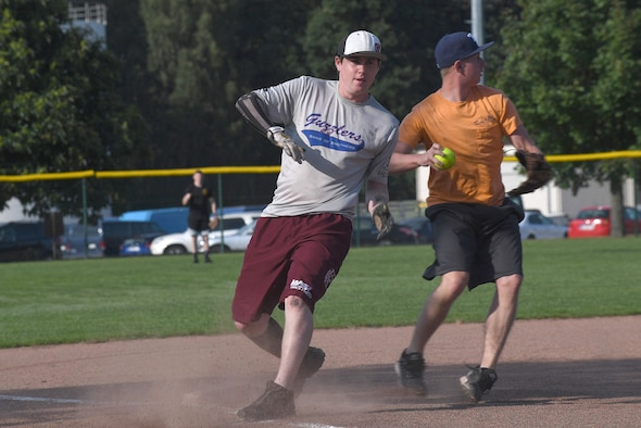 Kodie Bellew, 86th Maintenance Squadron softball player, makes it safely on a base during an intramural softball game Aug. 22, 2017, on Ramstein Air Base, Germany. Bellew played on the team as a dependent because his father works for the 86th MXS. (U.S. Air Force photo by Staff Sgt. Nesha Humes Stanton)