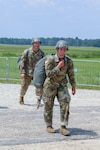 Cadet Meghan Copenhaver, a trainee at the U.S. Army Airborne School assigned to Alpha Company, 1st Battalion, 507th Parachute Infantry Regiment, returns from her first jump at Fryar Drop Zone at Fort Benning, Ga., Aug. 14, 2017. Copenhaver is the first fourth-generation Army paratrooper. Army photo by Markeith Horace