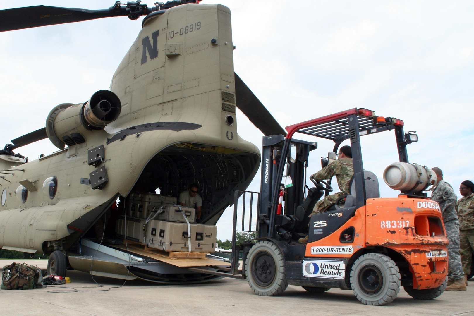 Cargo plane receives supplies loaded by forklift