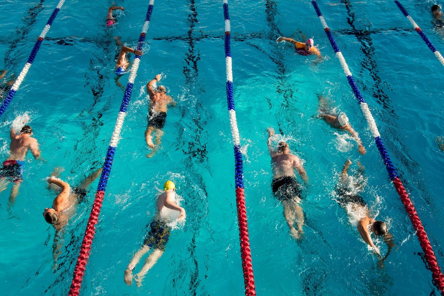 Participants swim during the Luke Triathlon held at Luke Air Force Base, Ariz., Aug. 19, 2017. Approximately 70 people completed the swim before moving on to the bike and running portions of the event. (U.S. Air Force photo/Staff Sgt. Jensen Stidham)