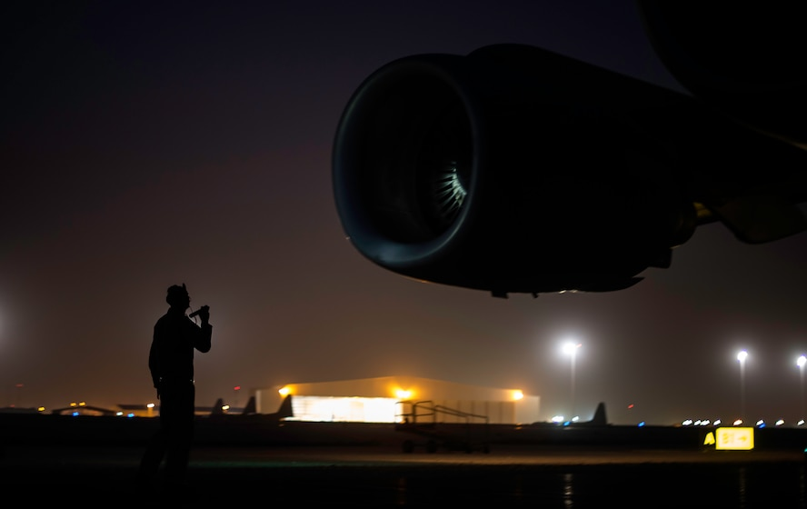A C-17 Globemaster III loadmaster, assigned to the 816th Expeditionary Airlift Squadron, performs pre-flight checks before a cargo supply mission in support of Operation Inherent Resolve at Al Udeid Air Base, Qatar, Aug. 18, 2017. The C-17 provides tactical airlift capabilities in the U.S. Central Command area of responsibility. (U.S. Air Force photo/Staff Sgt. Trevor T. McBride)