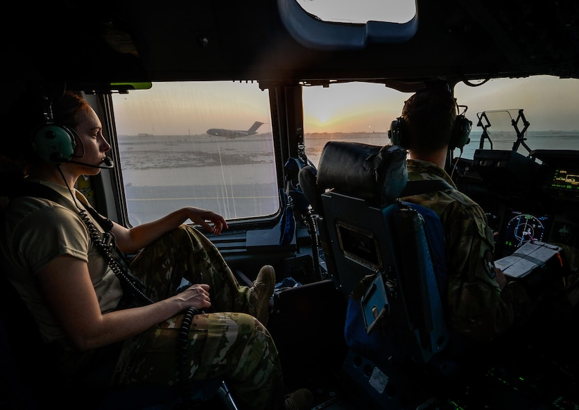 Airman 1st Class Elizabeth Silvers, left, an 816th Expeditionary Airlift Squadron C-17 Globemaster III loadmaster, and Capt. Travis Delzer, an 816th EAS C-17 pilot, prepare for takeoff before a mission in support of Operation Inherent Resolve, Aug. 23, 2017, at Al Udeid Air Base, Qatar. The C-17 is capable of rapid strategic delivery of troops and cargo and can be outfitted to perform tactical airlift, airdrop and aeromedical evacuation missions. (U.S. Air Force photo/Staff Sgt. Michael Battles)