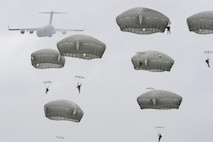 Paratroopers assigned to the 4th Infantry Brigade Combat Team (Airborne), 25th Infantry Division, U.S. Army Alaska, descend after jumping from a C-17 Globemaster III out of Joint Base Charleston, S.C., while conducting airborne training over Malemute drop zone, JB Elmendorf-Richardson, Alaska, Aug. 24, 2017. The Soldiers of 4/25 recently completed a series of jumps to ensure they maintain their airborne qualifications. (U.S. Air Force photo/Alejandro Peña)