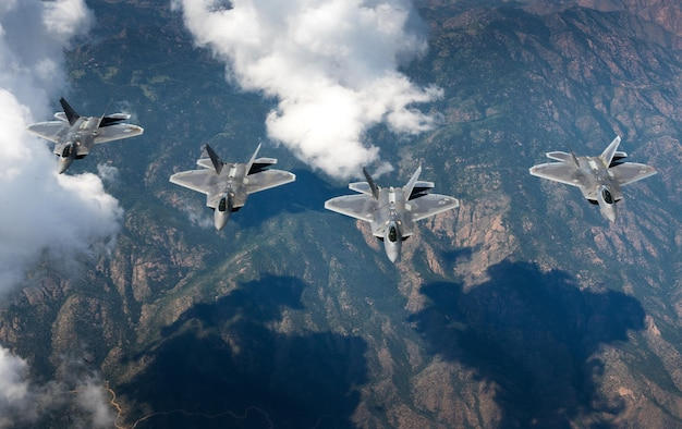 A four-ship formation of F-22 Raptors from the 94th Fighter Squadron and 1st Fighter Wing fly in formation over the Rocky Mountains in Colorado. The aircraft were in transit back to Joint Base Langley-Eustis, Va. after participating in Red Flag 17-4 Aug. 26, 2017. (U.S. Air Force photo/Staff Sgt. Carlin Leslie)