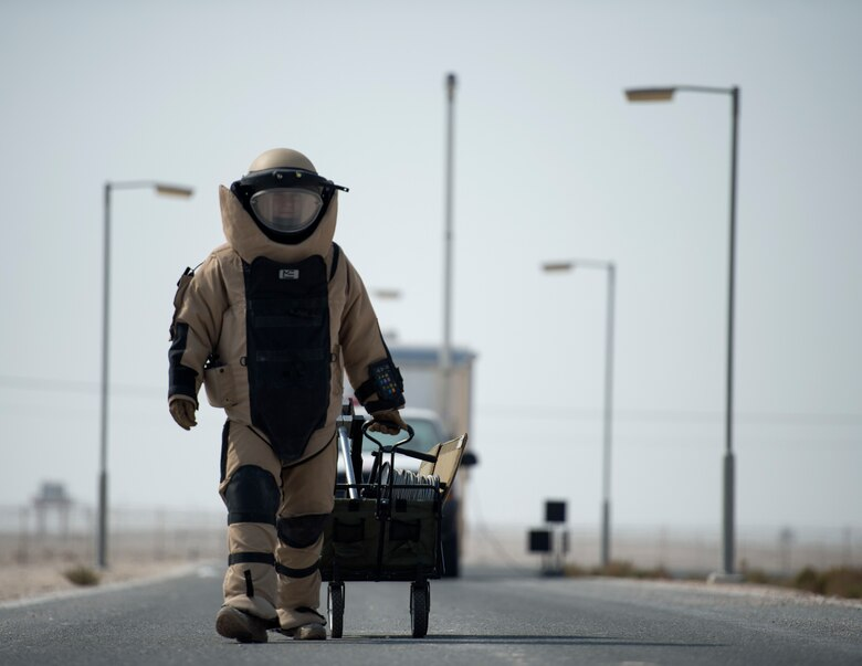 Staff Sgt. Brian Vosper, the 379th Expeditionary Civil Engineer Squadron explosive ordnance disposal flight team leader, walks to the vehicle search exercise location at Al Udeid Air Base, Qatar, Aug. 26, 2017. Vosper was participating in a vehicle search exercise where a military working dog with the 379th Expeditionary Security Forces Squadron, detected abnormalities with a vehicle. (U.S. Air Force photo/Tech. Sgt. Amy M. Lovgren)