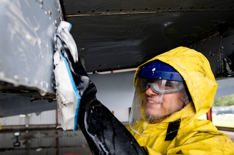 Airman 1st Class Jake Dromgold, 23d Aircraft Maintenance Squadron 74th Aircraft Maintenance Unit crew chief, washes under the wing of an A-10C Thunderbolt II, Aug. 28, 2017, at Moody Air Force Base, Ga. Maintenance procedures require that A-10s are washed at least every 180 days to prevent maintenance issues and safety hazards to the pilot. Since strong chemicals are used to clean the aircraft Airmen must wear personal protective equipment. (U.S. Air Force photo by Airman 1st Class Daniel Snider)