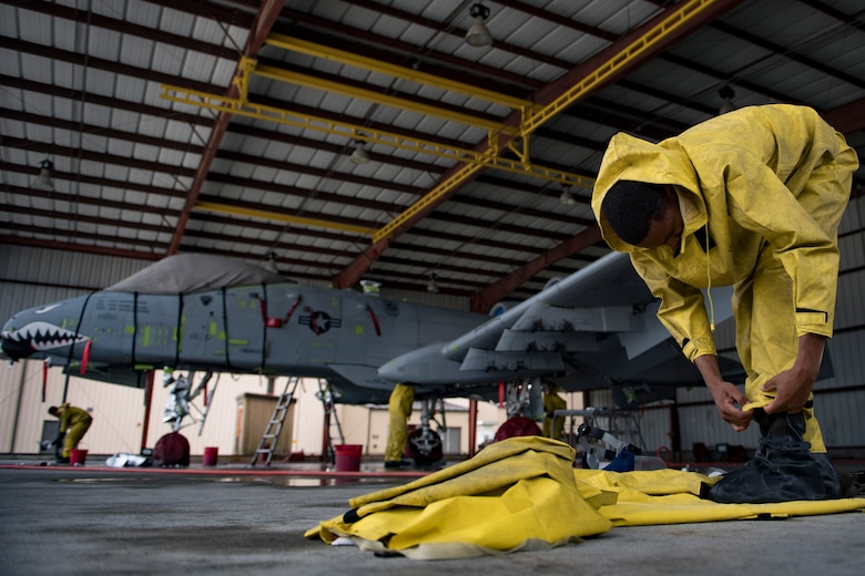 Airman 1st Class Michael Wilson-Jones, 23d Aircraft Maintenance Squadron 75th Aircraft Maintenance Unit electrical and environmental technician, dawns personal protective equipment before washing an A-10C Thunderbolt II, Aug. 28, 2017, at Moody Air Force Base, Ga. Maintenance procedures require that A-10s are washed at least every 180 days to prevent maintenance issues and safety hazards to the pilot. Since strong chemicals are used to clean the aircraft Airmen must wear personal protective equipment. (U.S. Air Force photo by Airman 1st Class Daniel Snider)