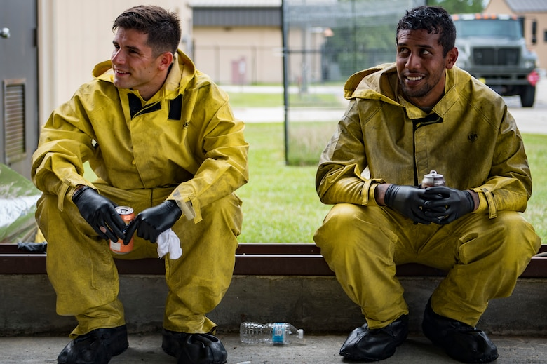 Airman 1st Class Jake Dromgold, left, and Senior Airman Daniel Ioane, both 23d Aircraft Maintenance Squadron crew chiefs, rest for a moment while washing an A-10C Thunderbolt II, Aug. 28, 2017, at Moody Air Force Base, Ga. Maintenance procedures require that A-10s are washed at least every 180 days to prevent maintenance issues and safety hazards to the pilot. Since strong chemicals are used to clean the aircraft Airmen must wear personal protective equipment. (U.S. Air Force photo by Airman 1st Class Daniel Snider)