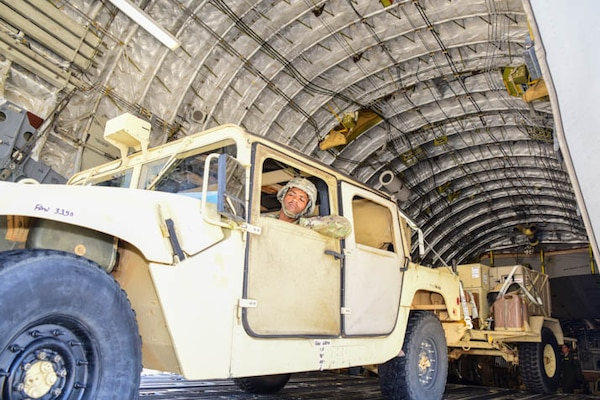 Soldiers from the 63rd Expeditionary Signal Battalion arrive with vehicles & equipment