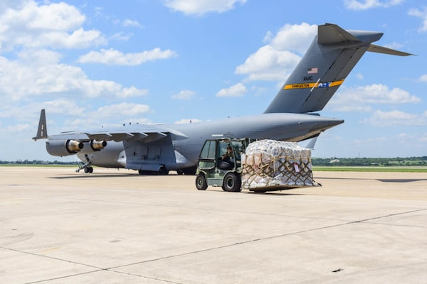 502D Logistical Readiness Squadron load a Lockheed C-130 Hercules on the flightline