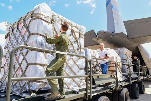 Texas Air National Guard airmen load a Lockheed C-130 Hercules on the flightline