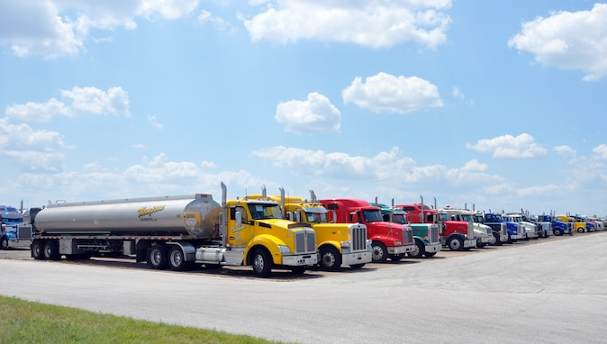 Fuel trucks in line on airfield tarmac
