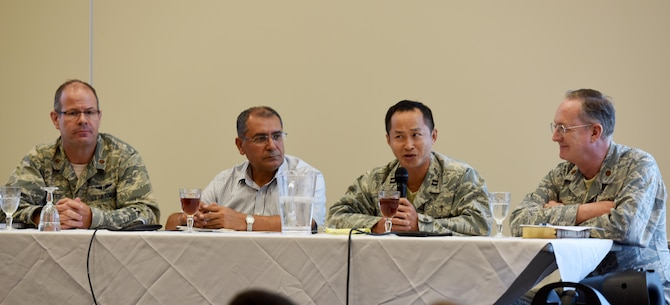 The lunch and religious panel discuss how they stay spiritually fit within their belief systems during a spirituality and religion forum Aug. 17, 2017, at Incirlik Air Base, Turkey. The lunch and enrichment forum focused on how practicing different belief systems can strengthen one's resilience. (U.S. Air Force photo by Senior Airman Jasmonet D. Jackson)