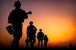 In 2010, U.S. marines depart a checkpoint during a patrol around Forward Operating Base Geronimo, Afghanistan.