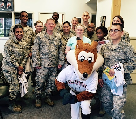 "Colorado Springs Sky Sox mascot ""Sox the Fox"" poses for a photo with Airmen Aug. 29, 2017 at the U.S. Air Force Academy. ""Sox"" dropped-off mail written to Airmen and cadets by the team's fan base. (U.S. Air Force photo/Laurie Wilson)"