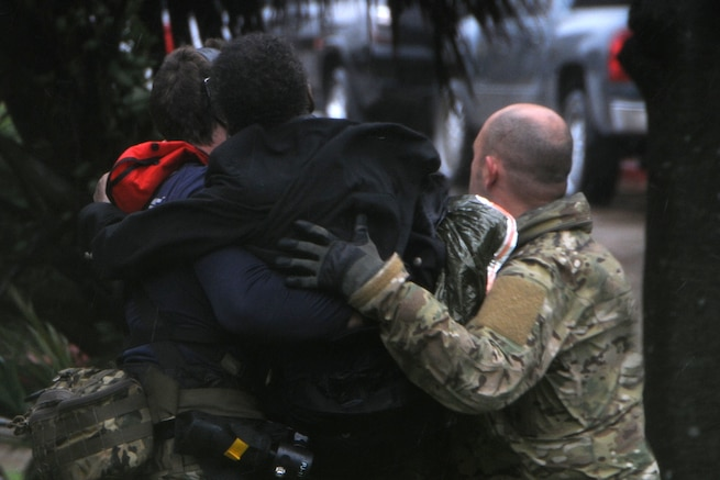 Two service members carry a person.