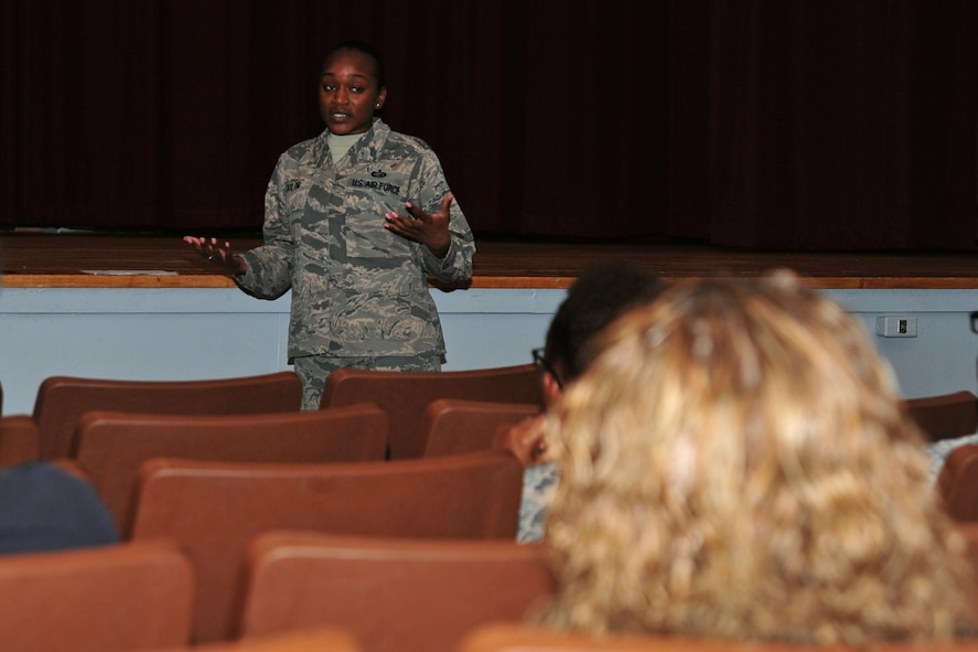 U.S. Air Force Staff Sgt. Brittany Taylor, 20th Force Support Squadron (FSS) noncommissioned officer in charge of outbound assignments, speaks to attendees during a Military Personnel Town Hall at Shaw Air Force Base, S.C., Aug. 31, 2017. Airmen assigned to the 20th FSS hosted the meeting to provided information regarding outbound assignments, high year of tenure extensions and enlisted professional military education. (U.S. Air Force photo by Airman 1st Class Kathryn R.C. Reaves)