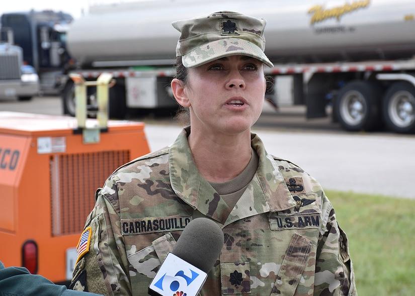 Lt. Col. Josielyn Carrasquillo speaks to reporters