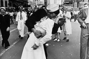 A sailor kisses a woman on VJ Day in New York City.