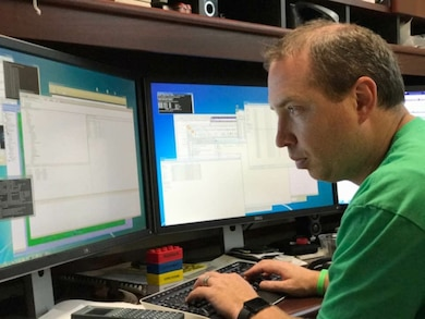 Aaron Byrd, civil research engineer in ERDC's Coastal Hydraulics Laboratory, works on inundation maps for the Houston area during Hurricane Harvey August 29.