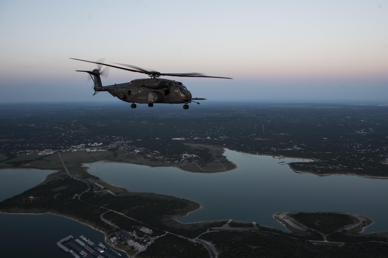 A Navy MH-53E Sea Dragon assigned to Helicopter Mine Countermeasures Squadron 15 at Naval Station Norfolk, Va., flies near Houston during rescue and recovery operations following Hurricane Harvey, Aug. 31, 2017. Air Force photo by Tech. Sgt. Larry E. Reid Jr.