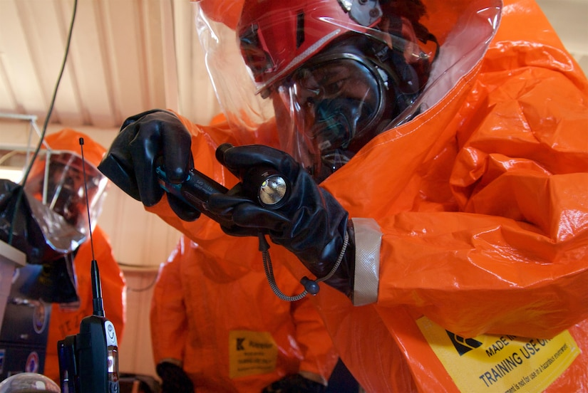 A joint hazard assessment team member takes hazmat instrument readings in a simulated hot zone during Kauai County Exercise 2017 at the Pacific Missile Range Facility in Kauai, Hawaii, Aug. 29, 2017. JHAT teams are tasked with gathering intelligence and environmental conditions in hazmat hot zones. Hawaii Air National Guard photo by Senior Airman Orlando Corpuz
