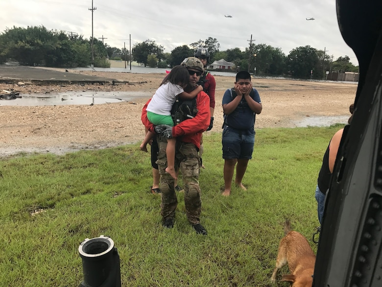 Rescue teams from the 920th Rescue Wing, Patrick Air Force Base, Florida, rescue stranded victims trapped by flooding from Hurricane Harvey Aug. 31, 2017 in Beaumont, Texas. The 920th RQW deployed roughly 90 Citizen Airmen, three Pave Hawks and two HC-130Ns in support of Air Force Northern's search and rescue mission for FEMA disaster relief efforts. (U.S. Air Force photo/Tech. Sgt. Lindsey Maurice)