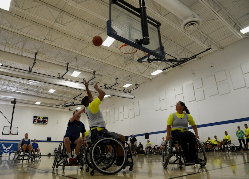 Participants of the Air force Wounded Warrior Program, play wheelchair basketball during the 2017 Joint Adaptive Sports Camp Aug. 29, 2017, at Joint Base Lewis-McChord, Wash.