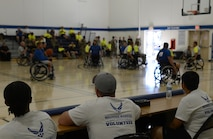 Volunteers for the Air Force Wounded Warrior Program keeps score during the 2017 Joint Adaptive Sports Camp wheelchair basketball games Aug. 29, 2017, at Joint Base Lewis-McChord, Wash.