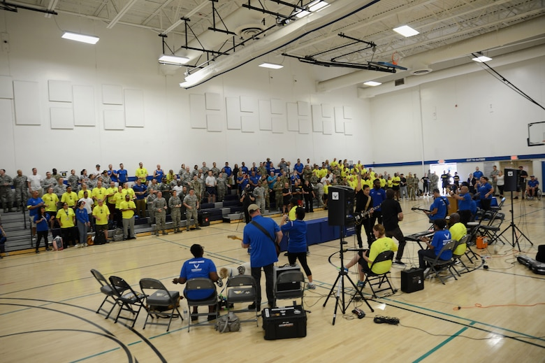 Air Force Wounded Warrior caregivers and ambassadors, play music during the closing ceremony of the Joint Adaptive Sports Camp Aug. 29, 2017, at Joint Base Lewis-McChord, Wash.