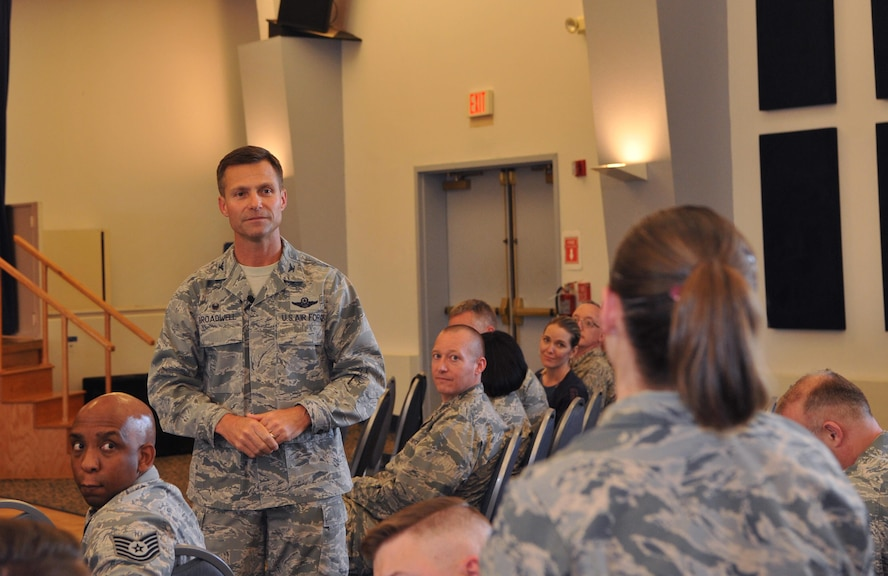 Col. Larry Broadwell, 9th Reconnaissance Wing commander, fields a question from an Airman during a town hall.
