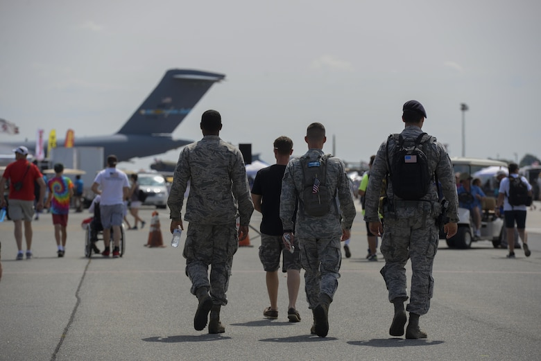 Airmen assigned to Dover Air Force Base complete a security patrol Aug. 27, 2017, during the Thunder Over Dover Open House at Dover AFB, Del. The open house is a way for Dover AFB to thank local and regional communities for their ongoing support. (U.S. Air Force photo by Staff Sgt. Aaron J. Jenne)