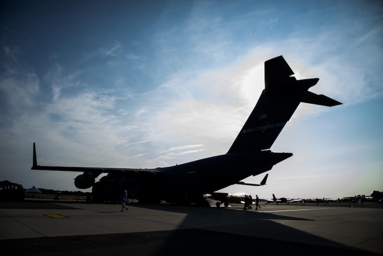 A silhouette of a C-17 Globemaster III before the start of the day during the 2017 Thunder Over Dover Open House Aug. 27, 2017, on Dover Air Force Base, Del. The C-17 was pulled by an Australian strong man on both days of the open house. (U.S. Air Force illustration by Staff Sgt. Jared Duhon)
