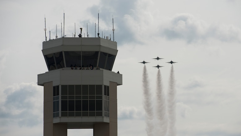 The U.S. Air Force Air Demonstration Squadron Thunderbirds move into the diamond formation fly pass Dover Air Force Base's air traffic control tower during the Thunder Over Dover Open House Aug. 27, 2017. The Thunderbirds performed precision flying maneuvers during the 2017 Thunder Over Dover Open House and Airshow Aug. 26 – 27. (U.S. Air Force photo by Senior Airman Zachary Cacicia)